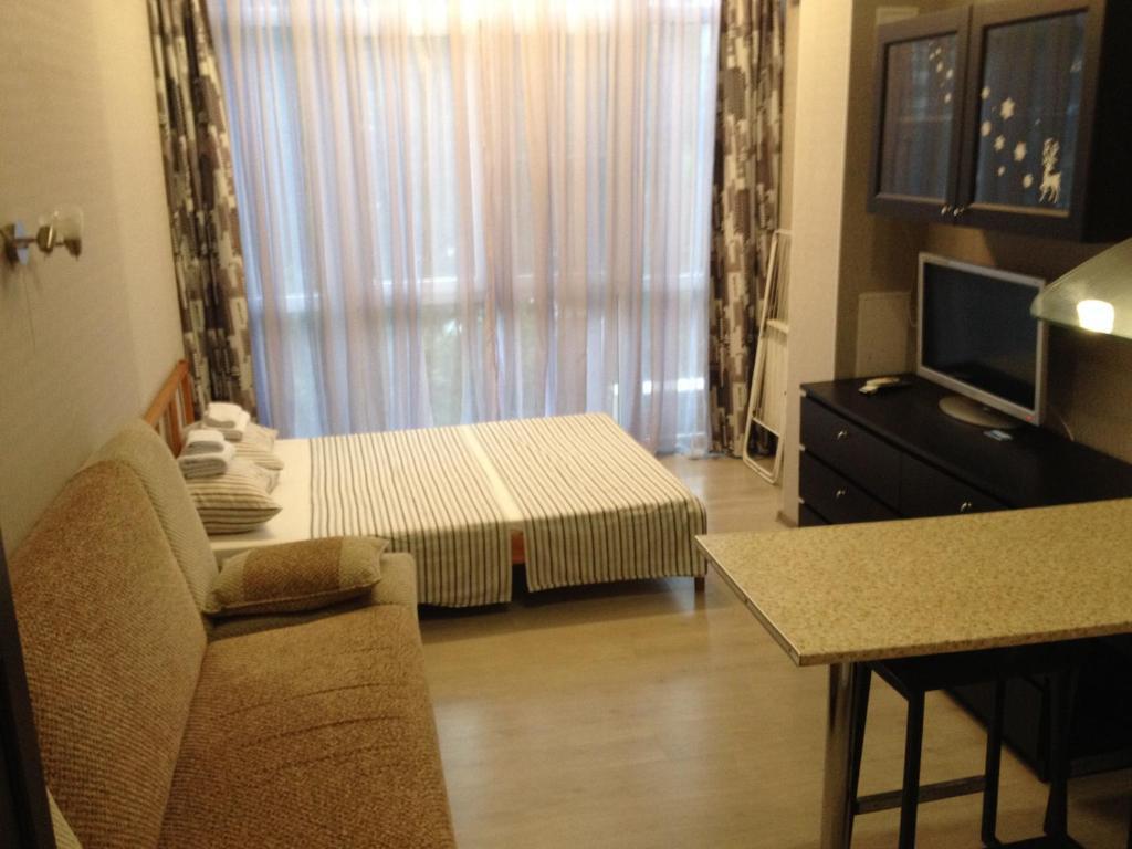 Кровать или кровати в номере Апартаменты у моря