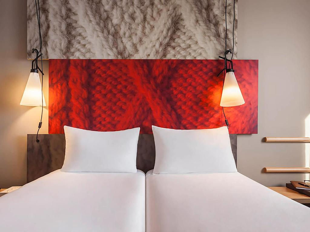 A bed or beds in a room at ibis Sens