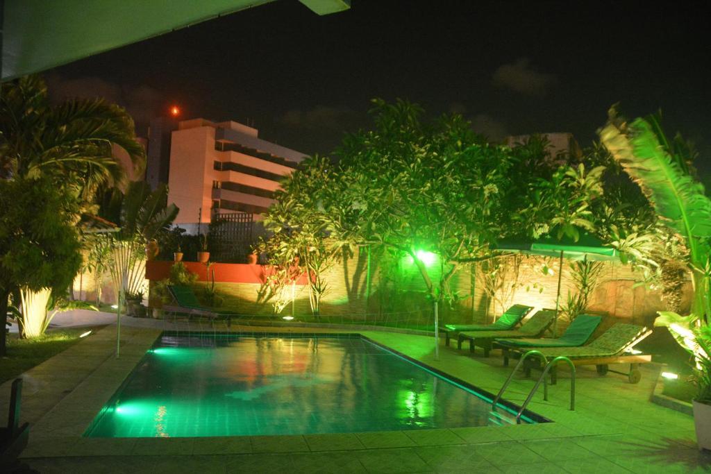 The swimming pool at or near Hotel Pousada Bossa Nova