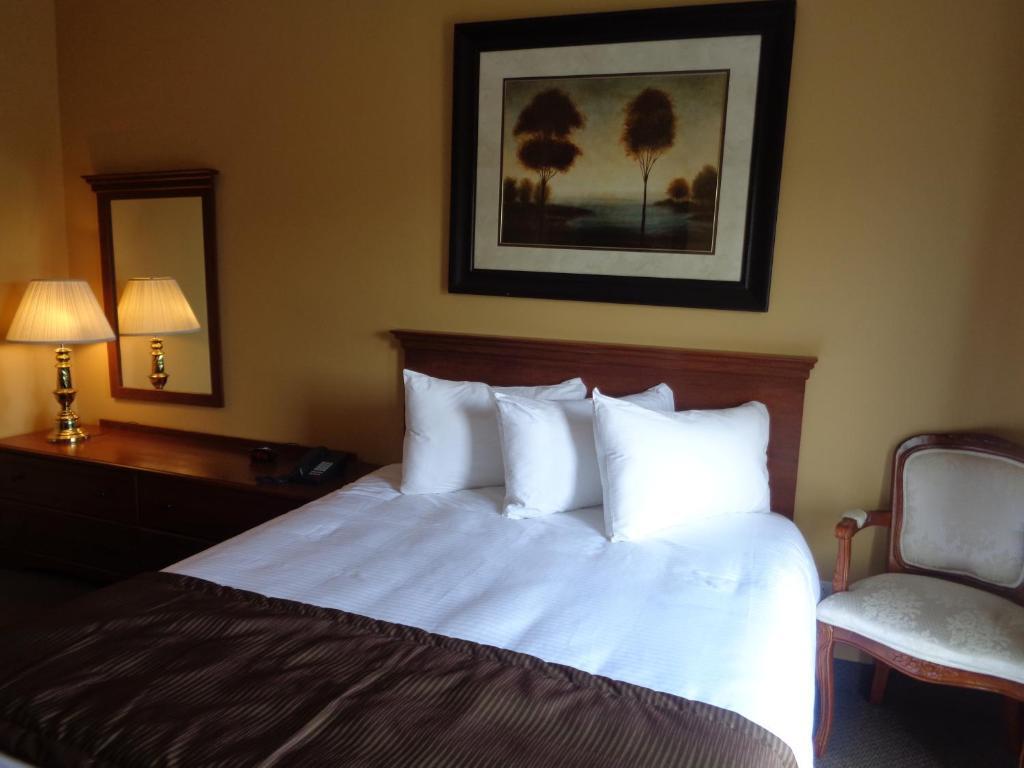 Un ou plusieurs lits dans un hébergement de l'établissement Motel Cofotel