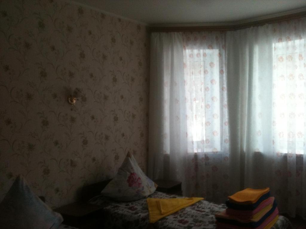 Кровать или кровати в номере Mini Hotel Ozero
