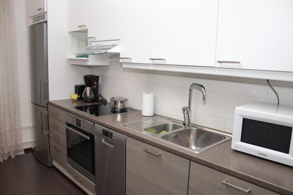 A kitchen or kitchenette at Lahti Center House