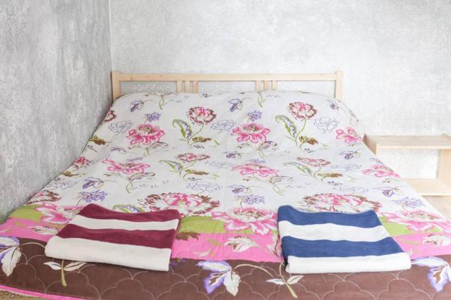 Кровать или кровати в номере Апартаменты на Ул. Пролетарская, д. 19