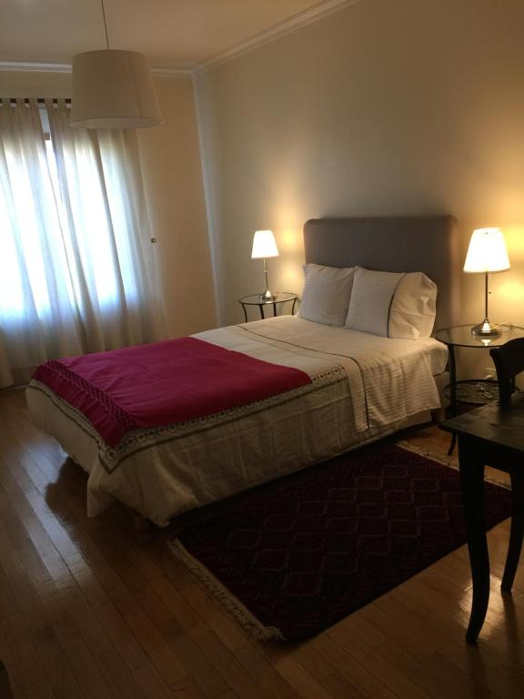 A bed or beds in a room at Apartamento Senadomum