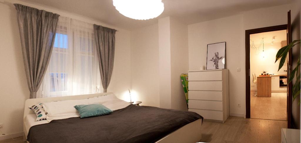 Łóżko lub łóżka w pokoju w obiekcie Kapart Home