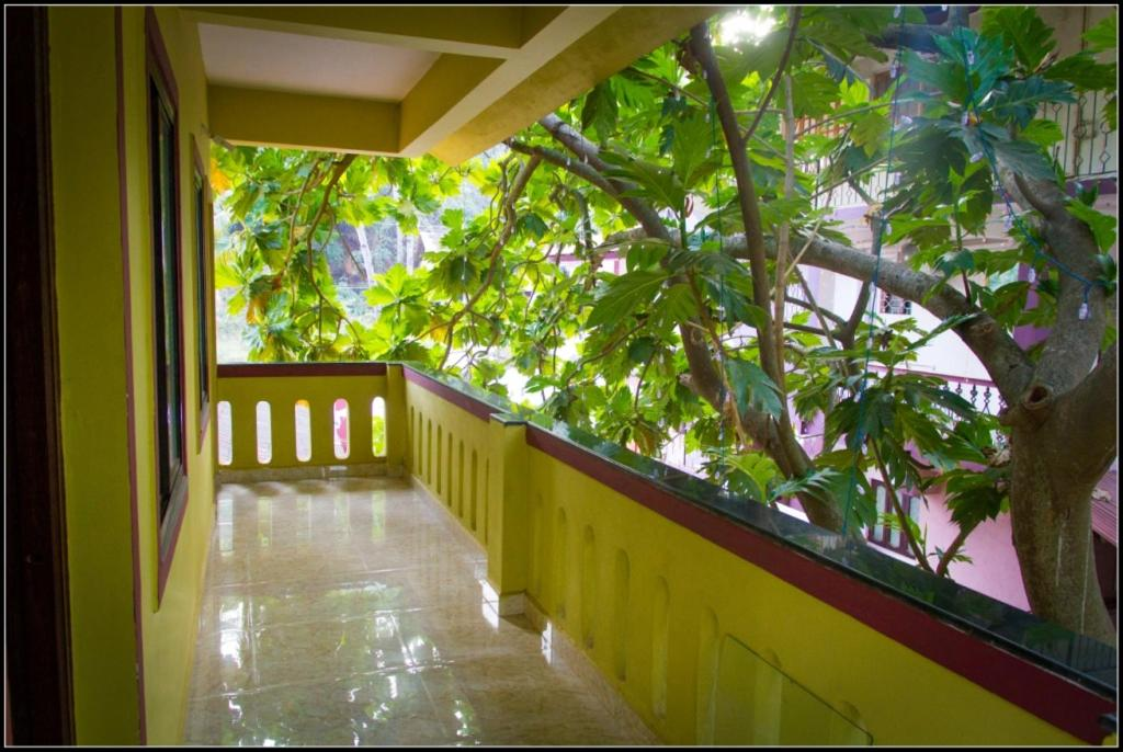 A balcony or terrace at All Seasons Guest House