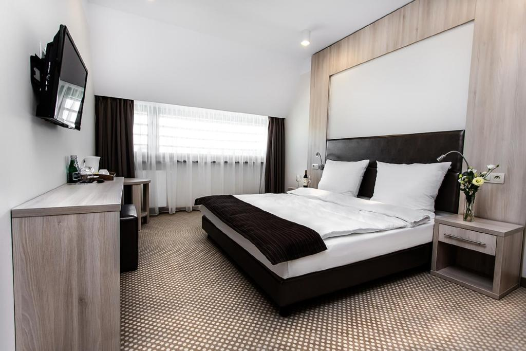 A bed or beds in a room at Hotel Antonio Conference