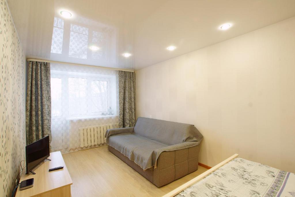 Гостиная зона в Apartment on Lokomotivnaya 1