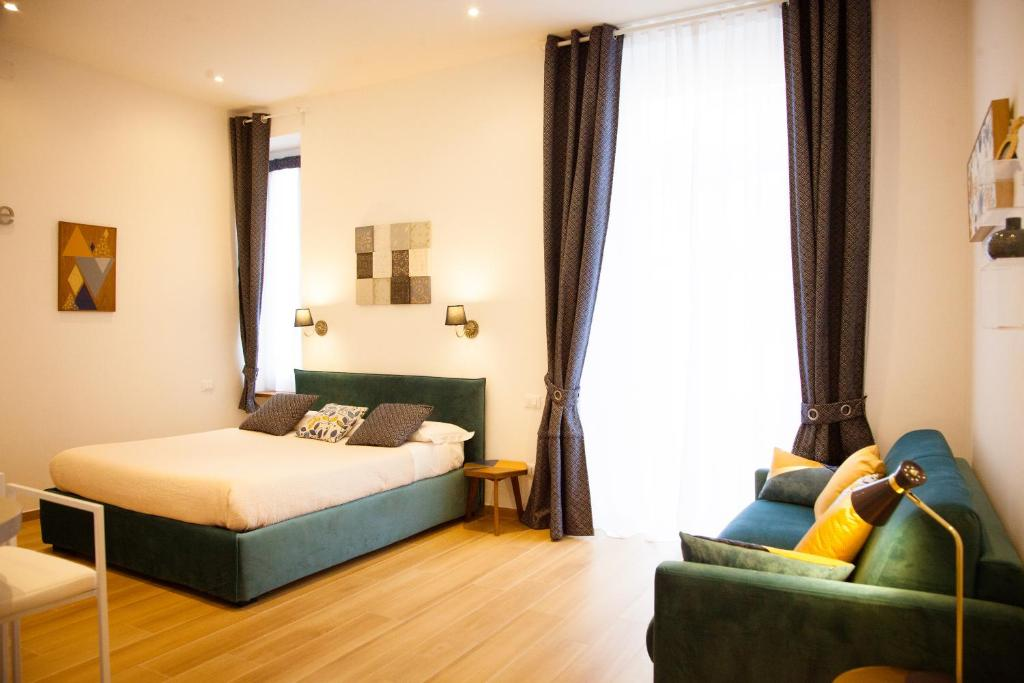 A bed or beds in a room at Apartments and Suites 5 Terre La Spezia