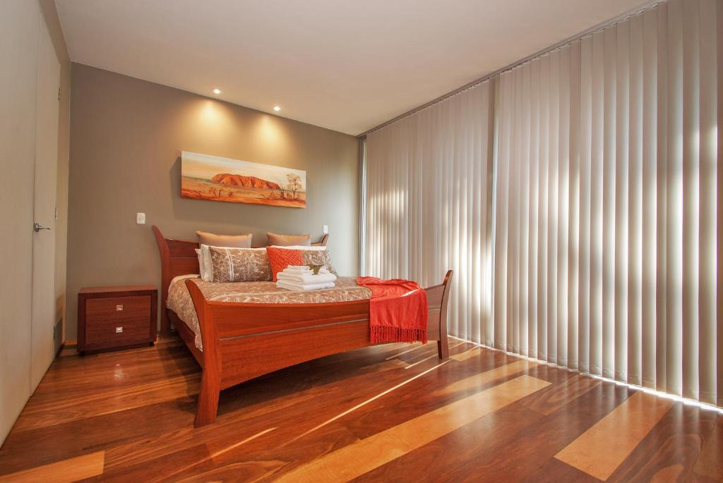 A bed or beds in a room at Centenary Peaks