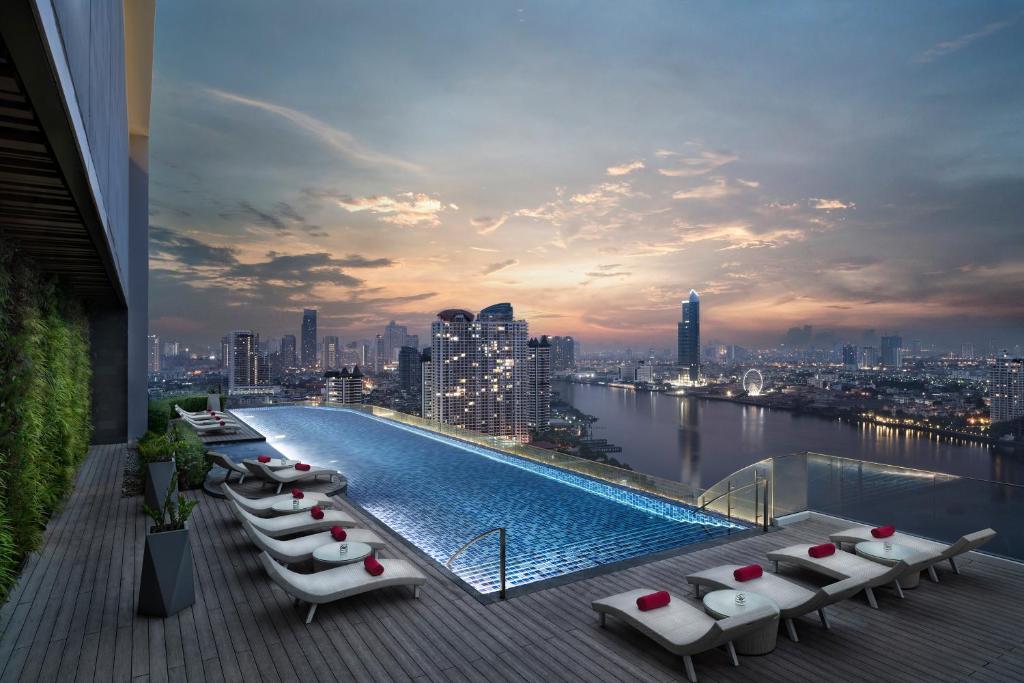 The swimming pool at or near Avani Plus Riverside Bangkok Hotel -SHA Certified