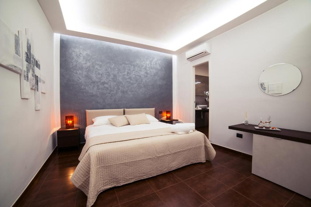 A bed or beds in a room at Glam House
