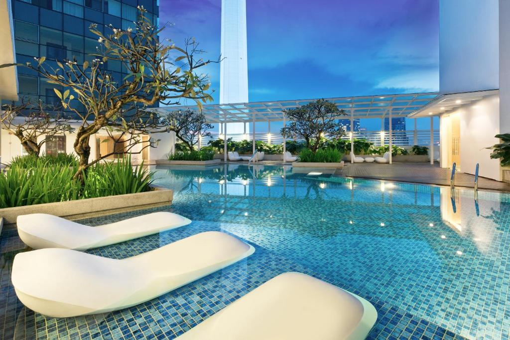 The swimming pool at or near Oasia Suites Kuala Lumpur by Far East Hospitality