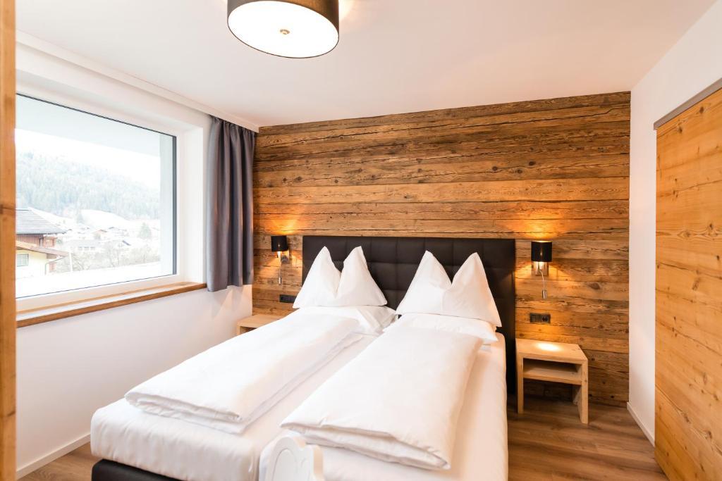 Ein Bett oder Betten in einem Zimmer der Unterkunft APART Forellenhof