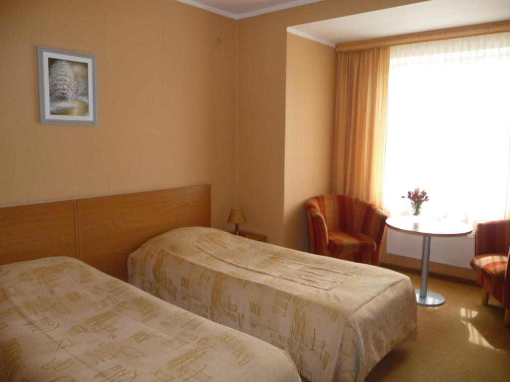 Posteľ alebo postele v izbe v ubytovaní Motel Tėvynė
