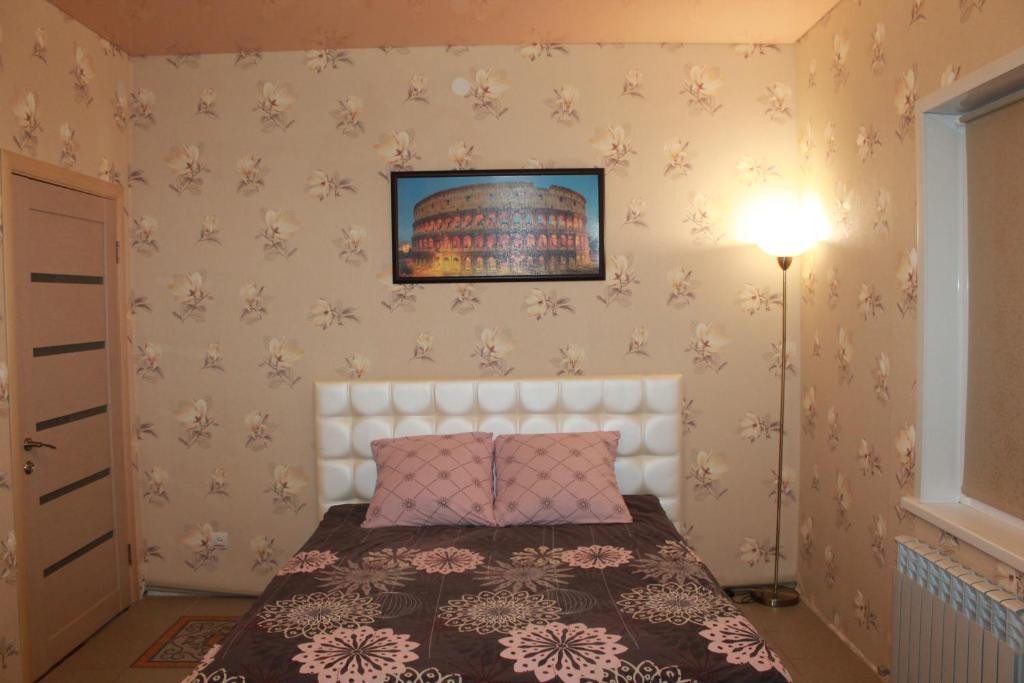 Кровать или кровати в номере Apartment on Lenina 49