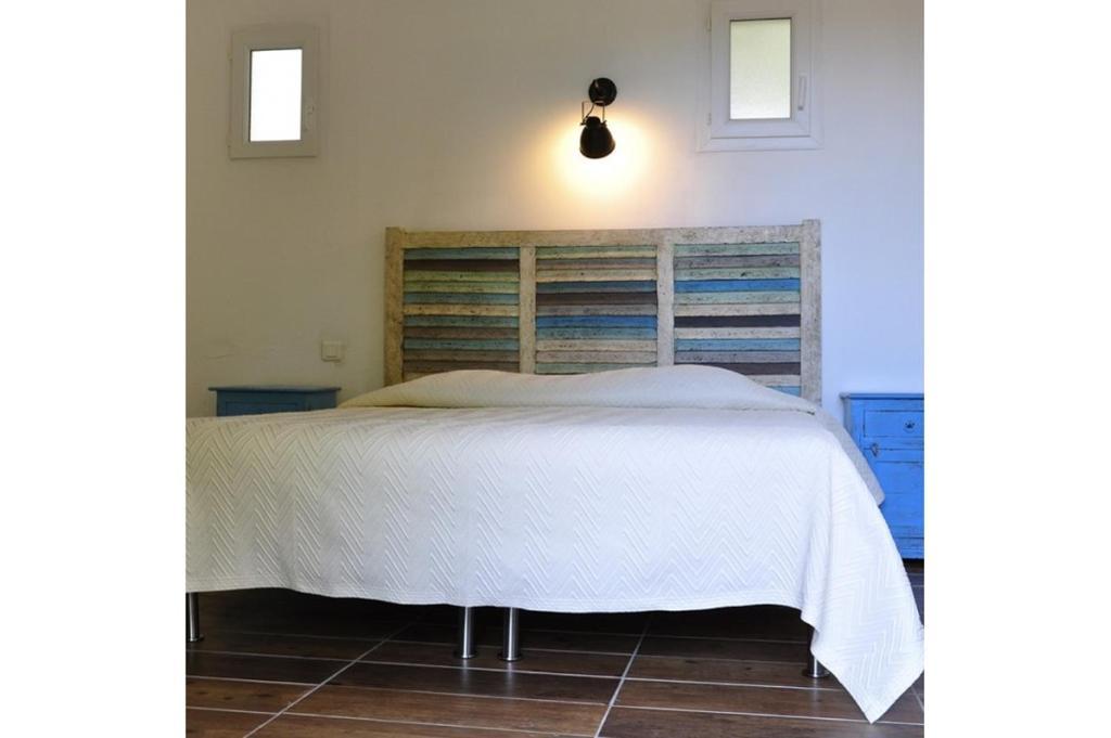 A bed or beds in a room at Hôtel Maora Village