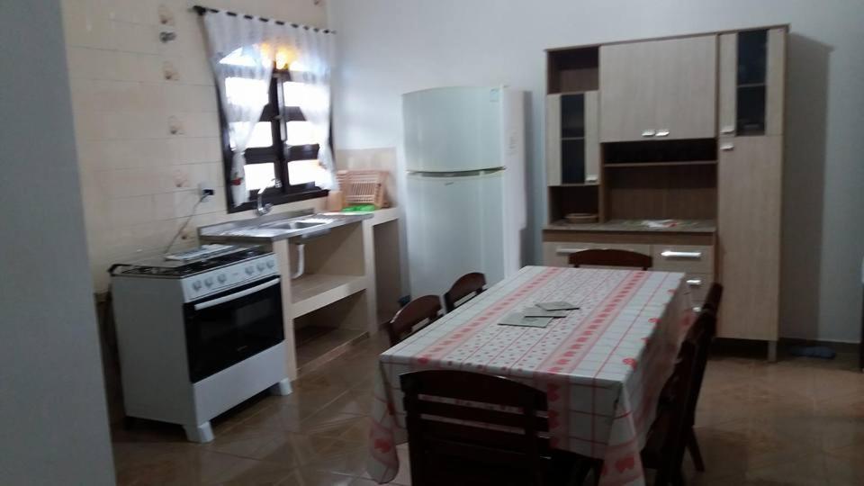 A kitchen or kitchenette at Vênus Apartamentos