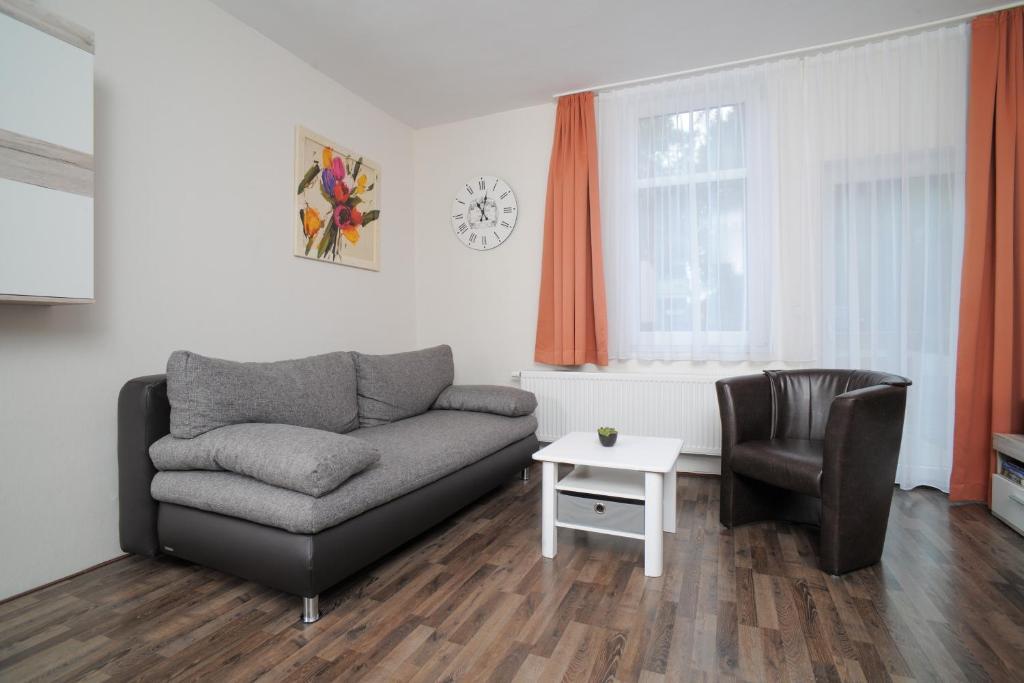 Ein Sitzbereich in der Unterkunft Le petit Palais - Apartments