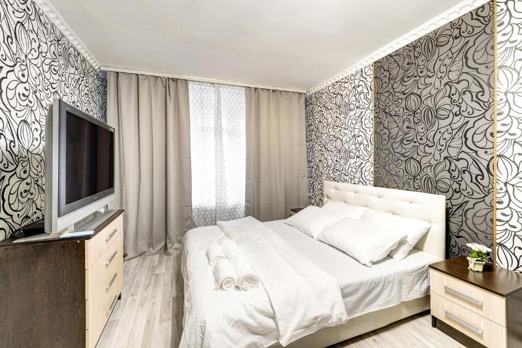 Кровать или кровати в номере Apartment on 2-ya Brestskaya 31