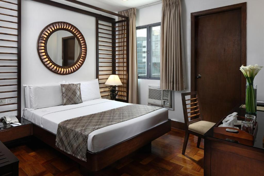 A bed or beds in a room at Manila Lotus Hotel