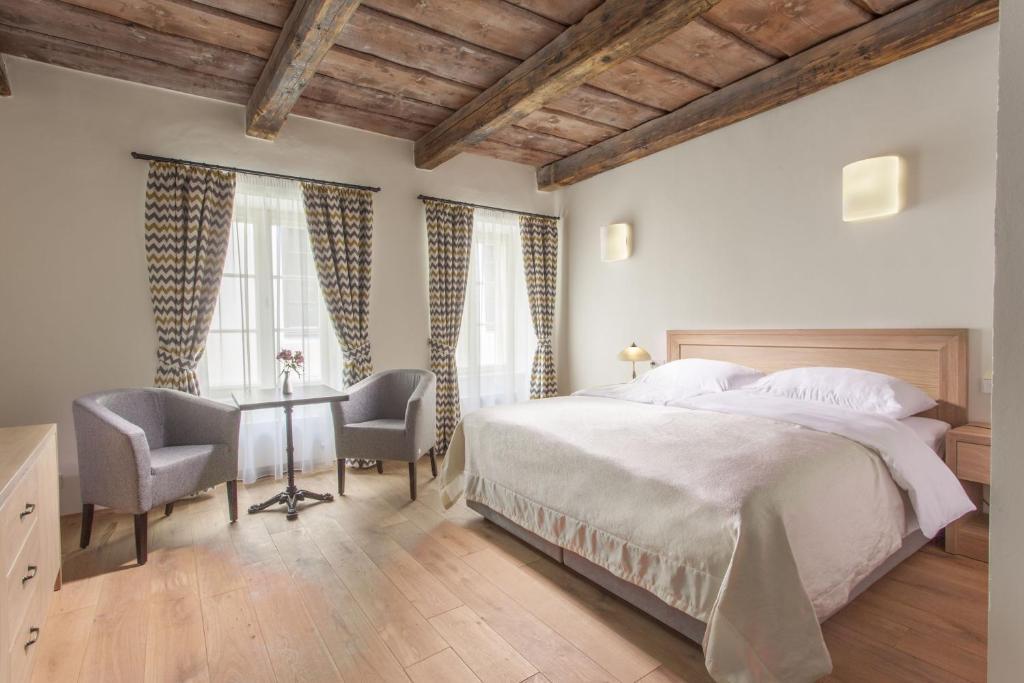 Postel nebo postele na pokoji v ubytování U Bílé Lilie