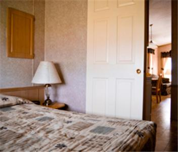 A bed or beds in a room at Red Shoes RV Park and Chalets
