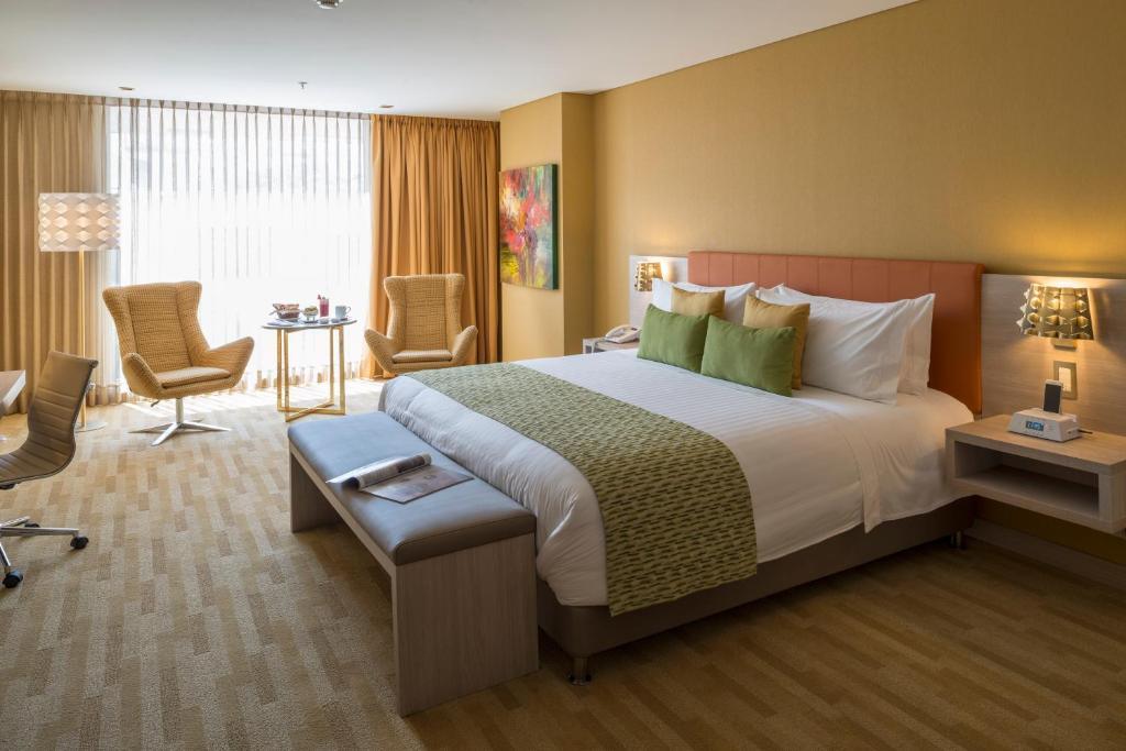 A bed or beds in a room at Hotel El Dorado Bogota