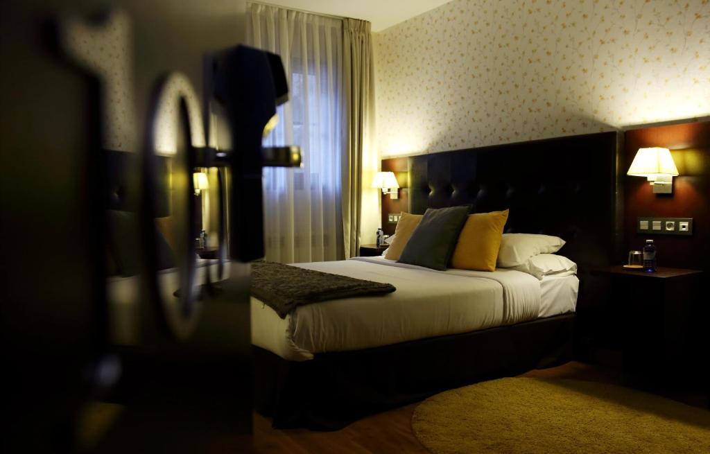Cama o camas de una habitación en Hotel Rural - El Rincón de Don Pelayo