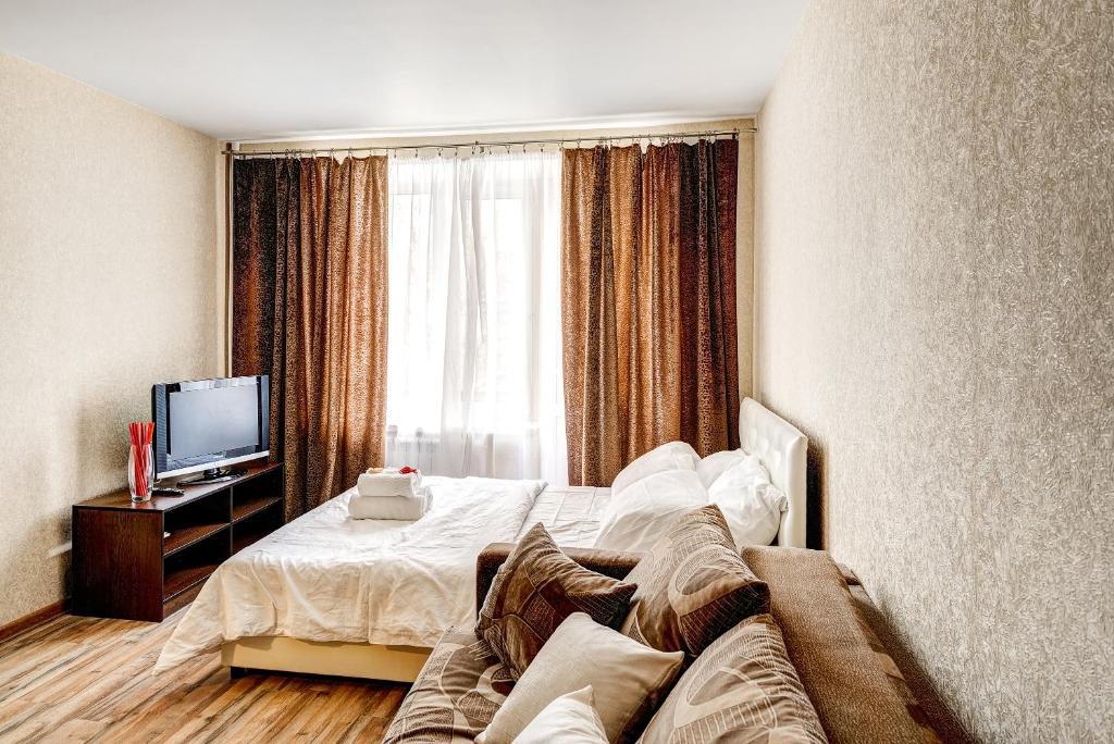 Кровать или кровати в номере Apartments Bolshoy Kondratyevskiy pereulok 8s1