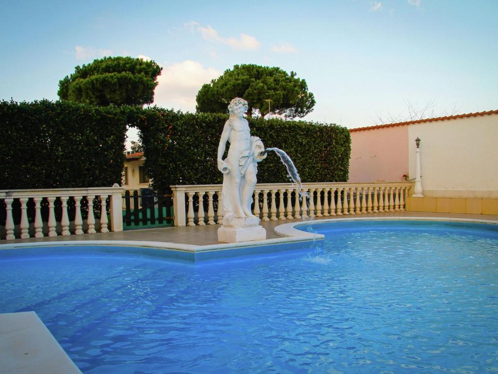 The swimming pool at or near Spacious villa with pool and jacuzzi in the countryside of Anzio