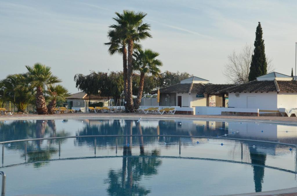 The swimming pool at or near Cabanas de Tavira Apartment