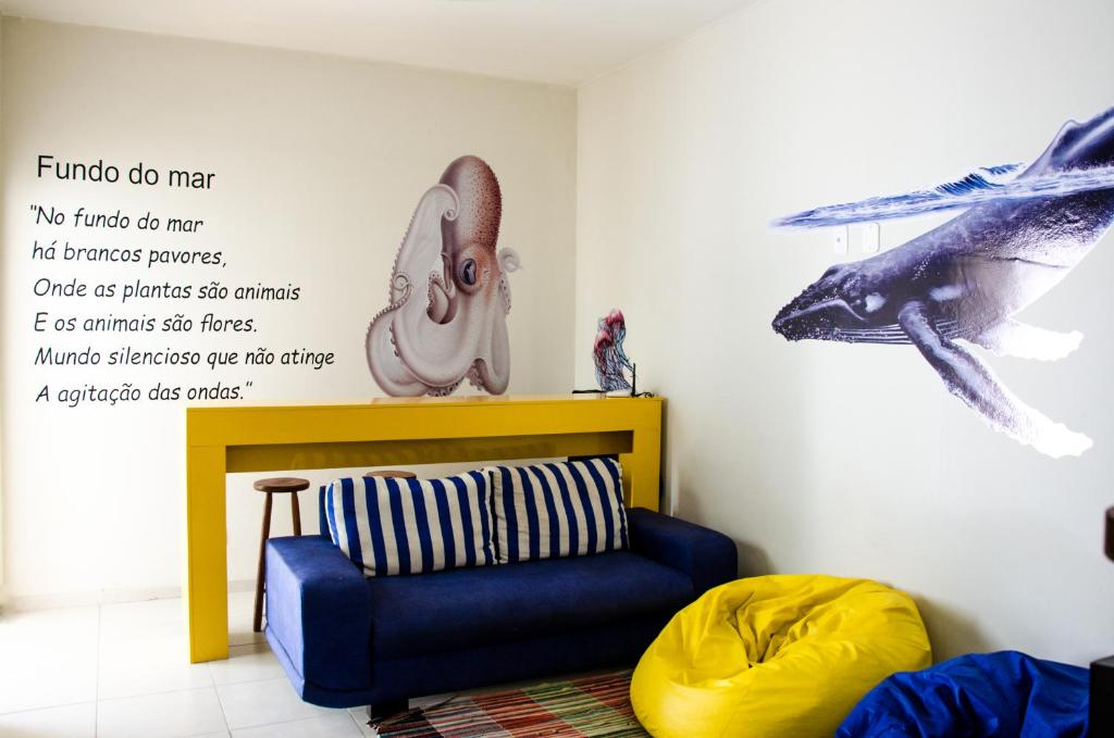 Uma área de estar em Hostel Vila Praiana