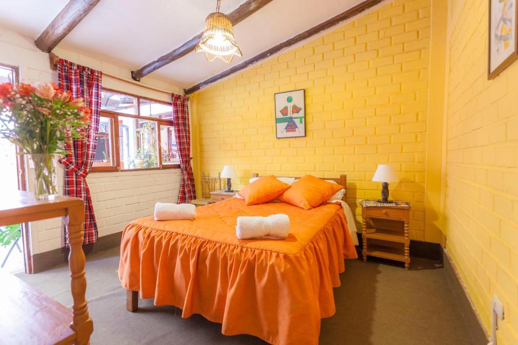A bed or beds in a room at Alojamiento Soledad