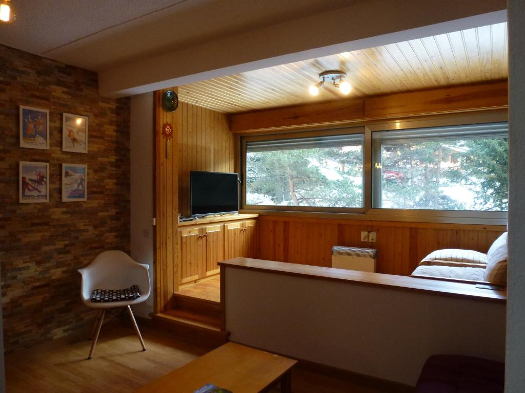A television and/or entertainment center at Apartment La Molina