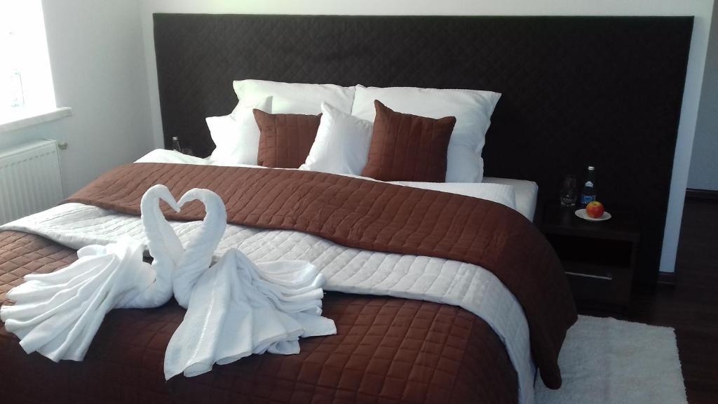 Łóżko lub łóżka w pokoju w obiekcie Noclegi Prestige