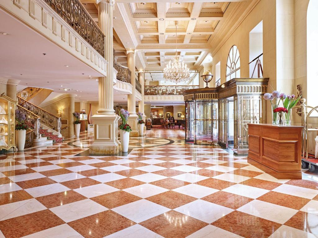 The lobby or reception area at Grand Hotel Wien