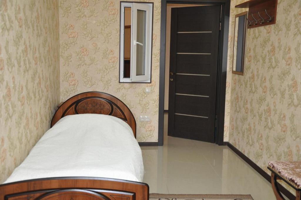 Кровать или кровати в номере Хостел Русь