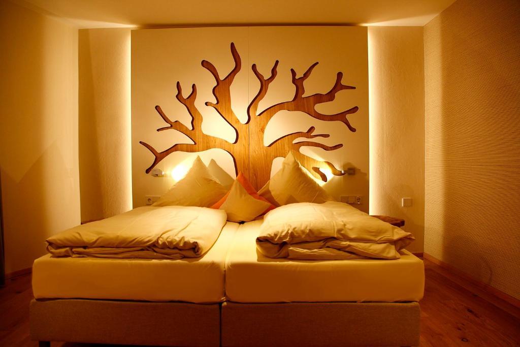 Ein Bett oder Betten in einem Zimmer der Unterkunft Flair Hotel Nieder