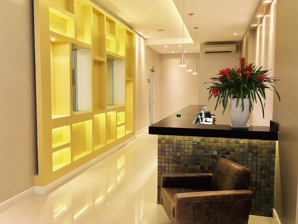 O saguão ou recepção de SW Praia Hotel
