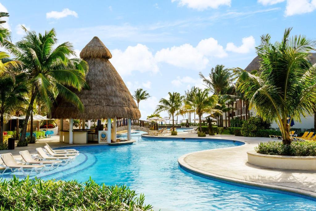 Der Swimmingpool an oder in der Nähe von The Reef Coco Beach & Spa- Optional All Inclusive