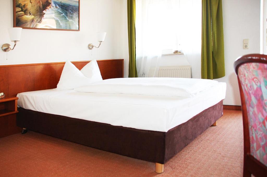 Кровать или кровати в номере CASILINO Hotel Rostocker Tor