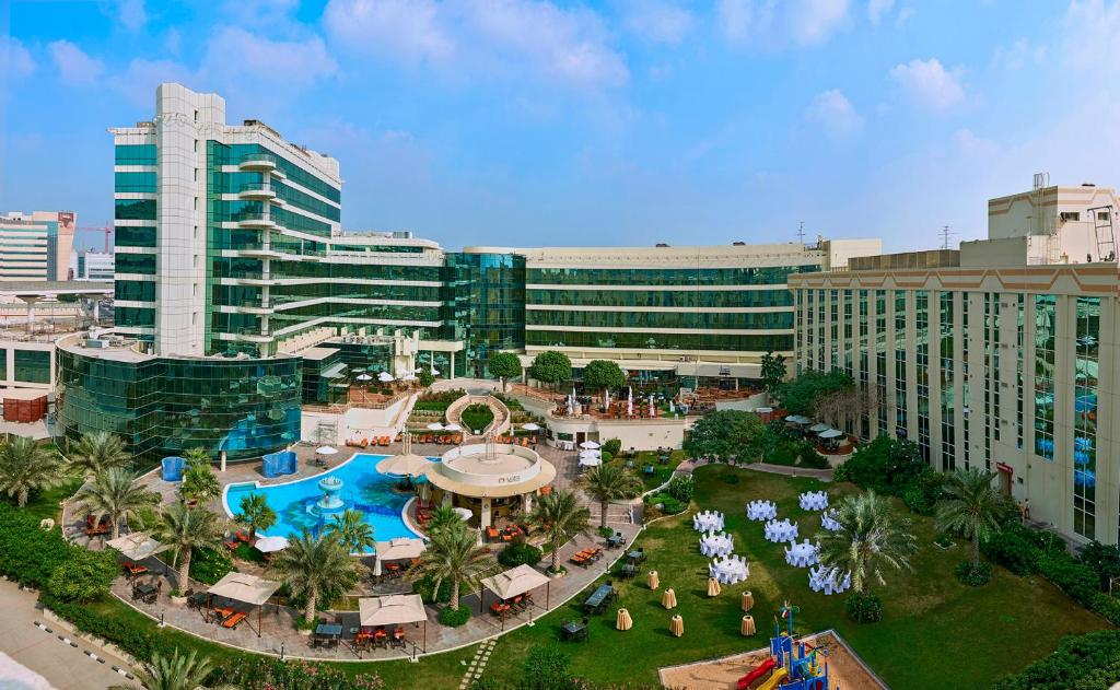 A view of the pool at Millennium Airport Hotel Dubai or nearby