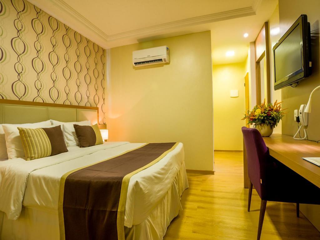 Cama ou camas em um quarto em Argentina Hotel
