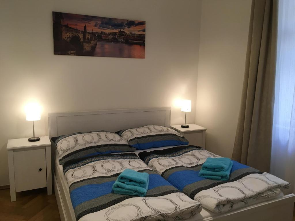 A bed or beds in a room at Astronomical Clock Apartment