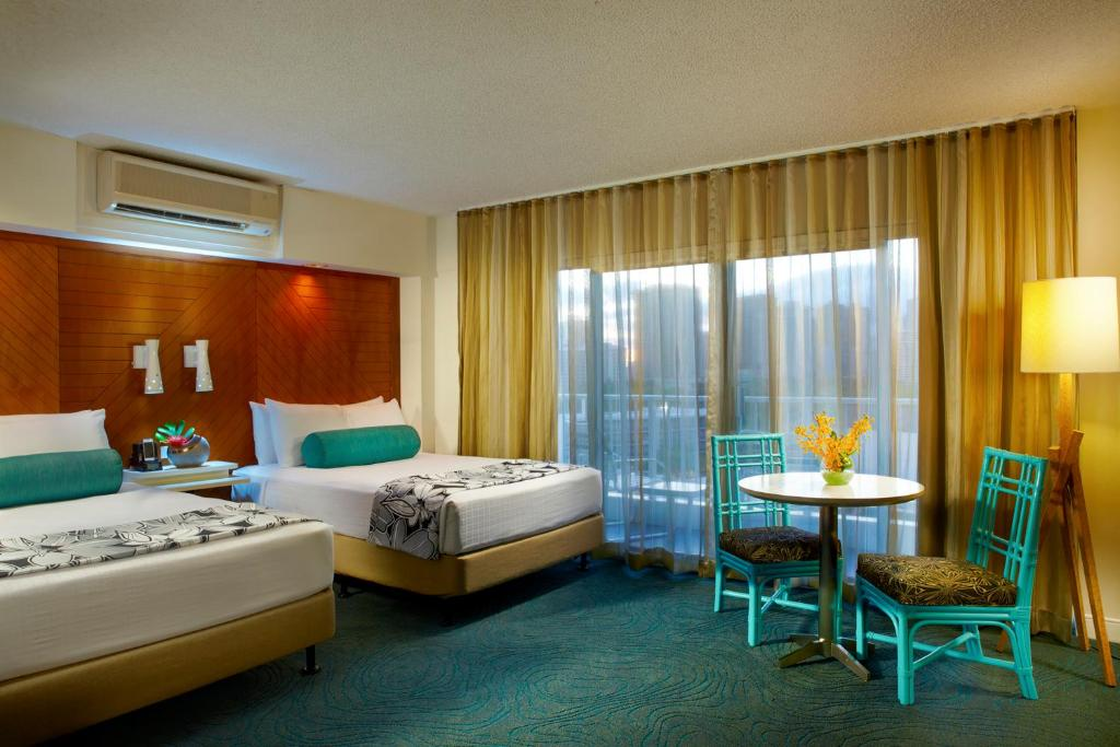 A bed or beds in a room at Aqua Oasis