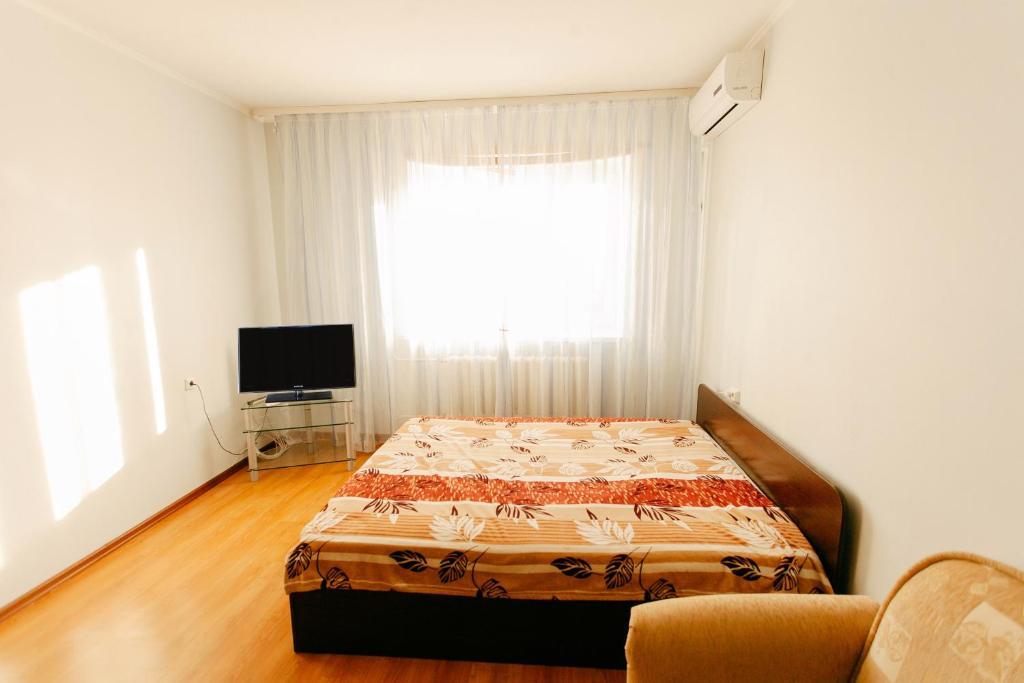 Кровать или кровати в номере 1-room Apartment in city Centre on Maksima Gorkogo street 83