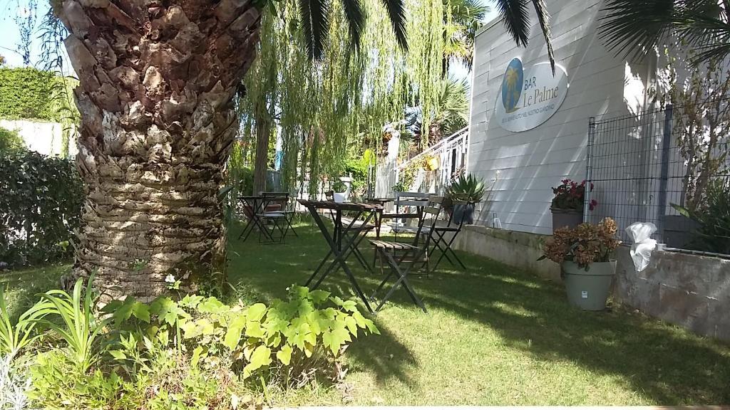 A garden outside Residence Le Palme