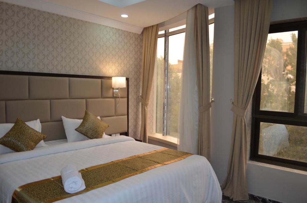 Cama ou camas em um quarto em Semac Apartment Hotel