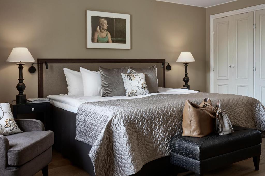 En eller flere senge i et værelse på Hotel Haven